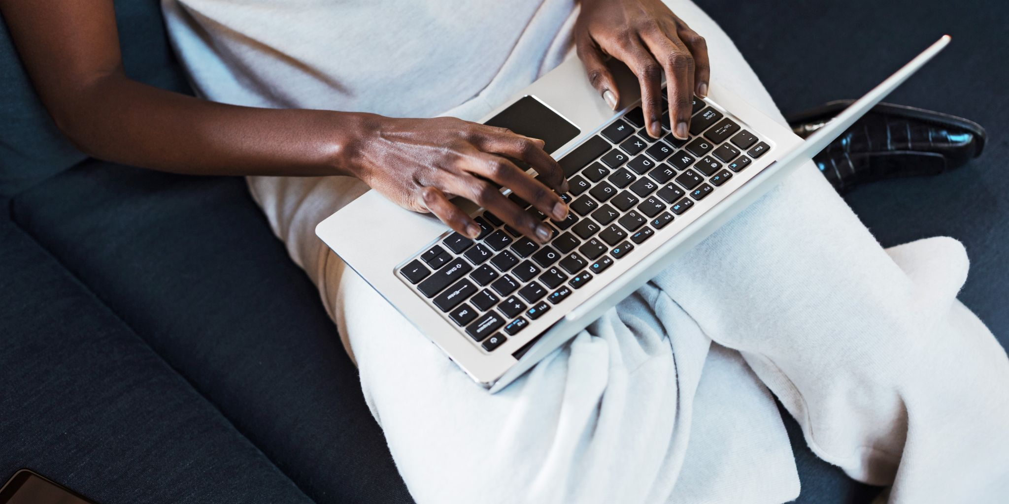 Businesswoman and businessman looking at a tablet together.